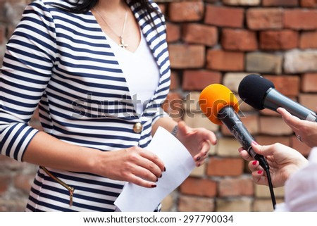 Journalists making interview with woman