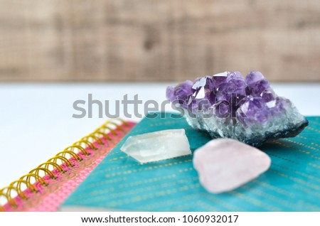journals with crystals on white background