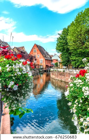 Journey through small river canals and streets in the city of Colmar or small Venice, France