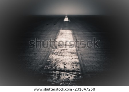 Journey to nowhere. Abstract creative photo of a dramatic dark road and sky.