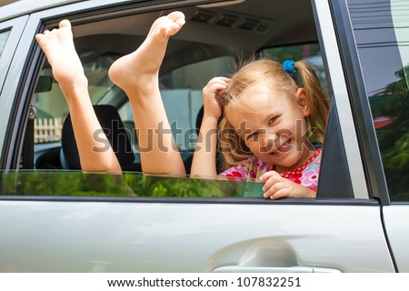 joy a child looks out from a car window