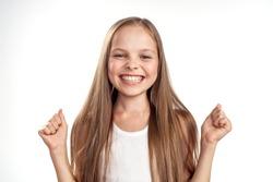 joy on the girl face on a light background