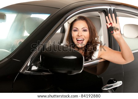 Joyful Asian Female Driver Look Out of Car Window Holding Keys