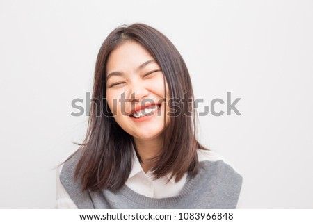 Joyful asian young Women smiling to camera on white background