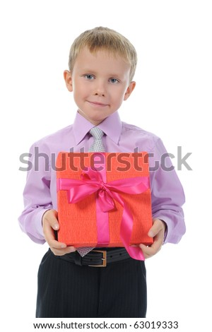 Joyful boy holding present box . Isolated on white background