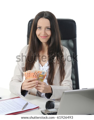 Joyful businesswoman in the office with a bundle of euro banknotes. Isolated on white