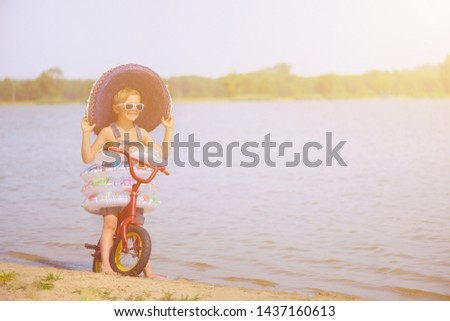 Joyful child enjoys a holiday in the water with swimming rings. Joy of freedom and life. #1437160613