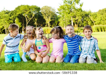 Joyful children on green grass