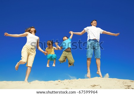 Joyful family jumping together during vacation