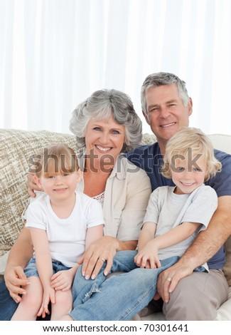 Joyful family looking at the camera at home