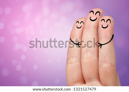 Joyful fingers smiling with colorful background concept #1321527479