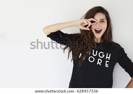 Joyful girl having fun in studio, portrait