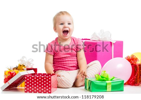 Joyful kid girl with colorful gifts. Isolated on white.