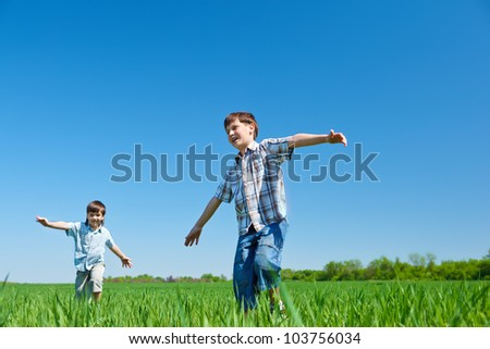 Joyful kids running in the countryside