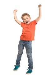 JOYFUL LITTLE BOY SUPPORTING WITH HANDS UP WHILE STANDING ISOLATED ON WHITE BACKGROUND