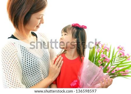 Joyful little girl holding flowers in hand