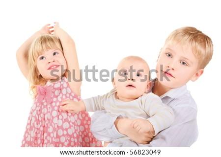 joyful little girl, little boy and baby. little boy is holding baby. isolated.