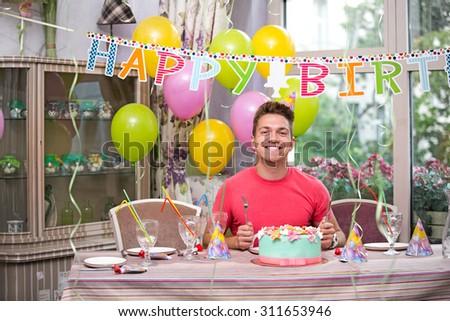 Joyful man at a birthday party