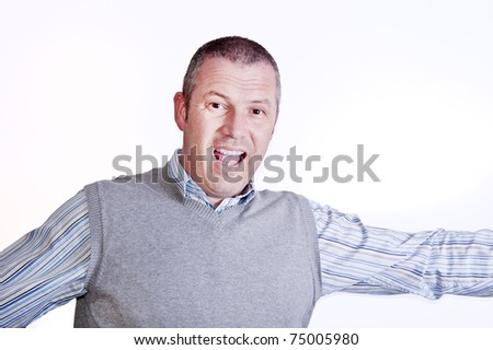 Joyful middle aged white man with arms spread and smiling