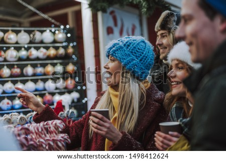 Joyful mood. Joyful woman keeping mouth opened while being surprised with collection of sweets