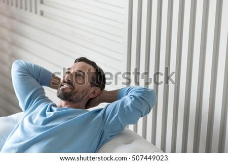 Joyful optimistic man having a wonderful mood