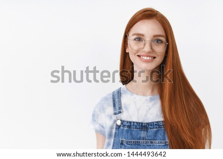 Joyful outgoing attractive redhead european girl long red hairstyle wear glasses smiling cheerful, listen lively conversation, stand carefree white background, small talk near university campus