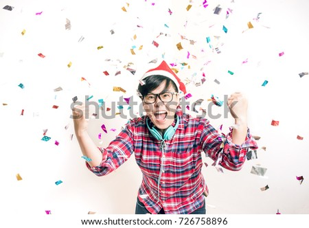 Joyful Party Concept - One Asian People Having Fun and Enjoy with Colorful Confetti in Surprise and Excite Emotion #726758896