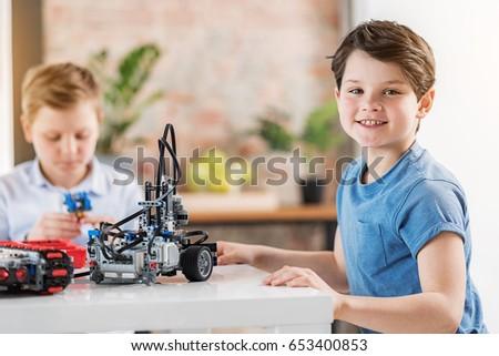 Joyful smiling boy in workshop