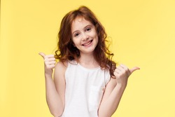 Joyful sunny child smiling and showing sign class