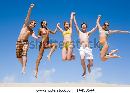 stock photo : Joyful team of friends holding for hands each other and