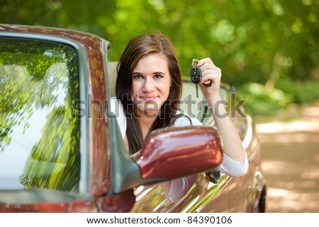 stock photo joyful teenager female driver holding car key arm out in convertible 84390106 Fresh & Free High Quality Pass Accounts [username + password] 100% Working ...