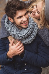 Joyful woman embracing man with love