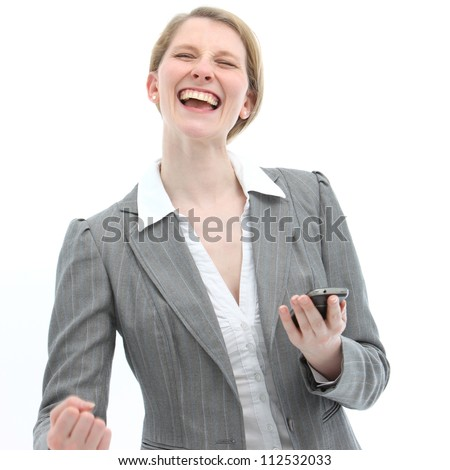 Joyful woman laughing and gesturing with her fist reacts to receiving good news on her mobile phone which she is holding