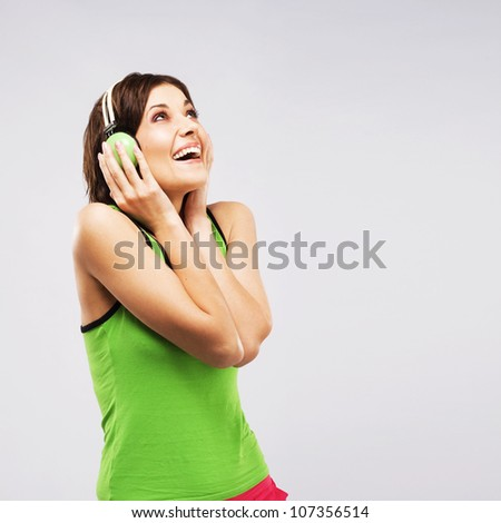 Joyful woman listening a music in headphones