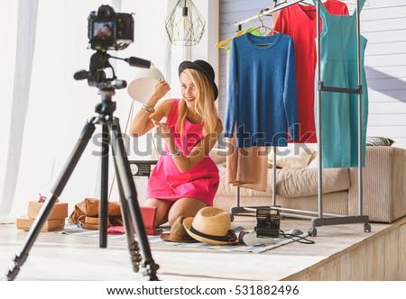 Joyful woman maintaining fashion blog