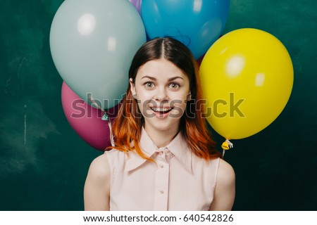 Joyful woman with balloons, the girl is happy, the girl is smiling with joy, joy and happiness #640542826