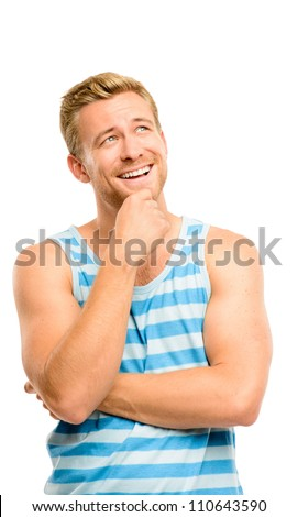 Joyful young man looking up thinking isolated on white background