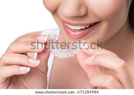 Joyful young woman undergoing clear-aligner treatment