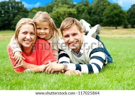 Joyous family in a park enjoying day out. Sunny spring day