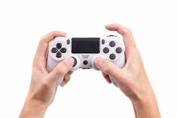 Joystick gaming controller in hand isolated on white background , Video game console developed Interactive Entertainment
