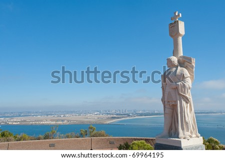 Juan Rodri­guez Cabrillo statue and panorama of San Diego, California