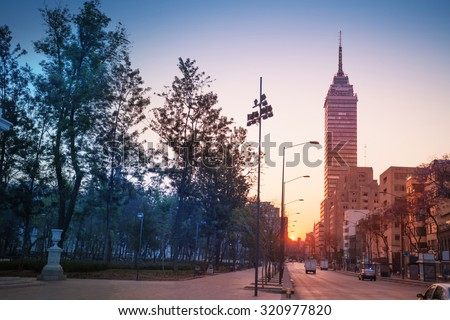 Juarez Avenue near central Alameda park and Torra Latina in morning sunrise, Mexico city