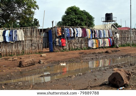 JUBA - JUNE 11: An unidentified man arranges shirts for sale at a clothing store on a downtown street in Juba, South Sudan, on June 11, 2011. South Sudan is one of the most undeveloped countries.