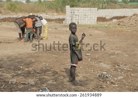 JUBA, SOUTH SUDAN - FEBRUARY 26: Unidentified kids play on a street of Juba on February 26, 2012 in Juba, South Sudan. Juba is full of refugees who live with their children in appalling conditions.