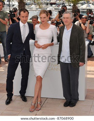 Jude Law (left), Uma Thurman & Robert De Niro at the photocall for the jury at the 64th Festival de Cannes. May 11, 2011  Cannes, France Picture: Paul Smith / Featureflash