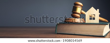 Judge auction and real estate concept. House model, gavel and law books  ストックフォト ©