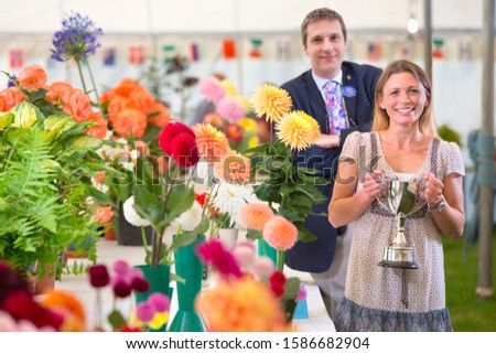Judge Awarding Trophy At Flower Show