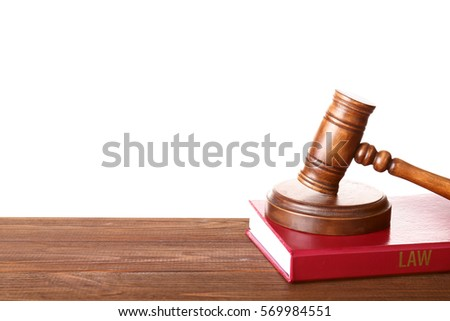 Judge gavel and book on wooden table