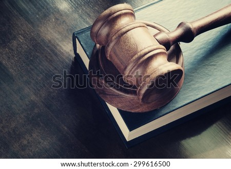 Judge gavel and legal book on wooden table, justice and law concept