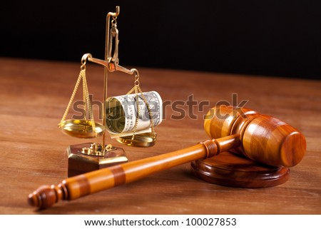judge gavel and scales with money